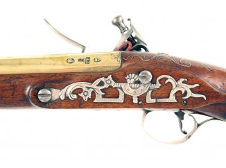 A Silver Mounted Flintlock Holster Pistol by Brueton of London