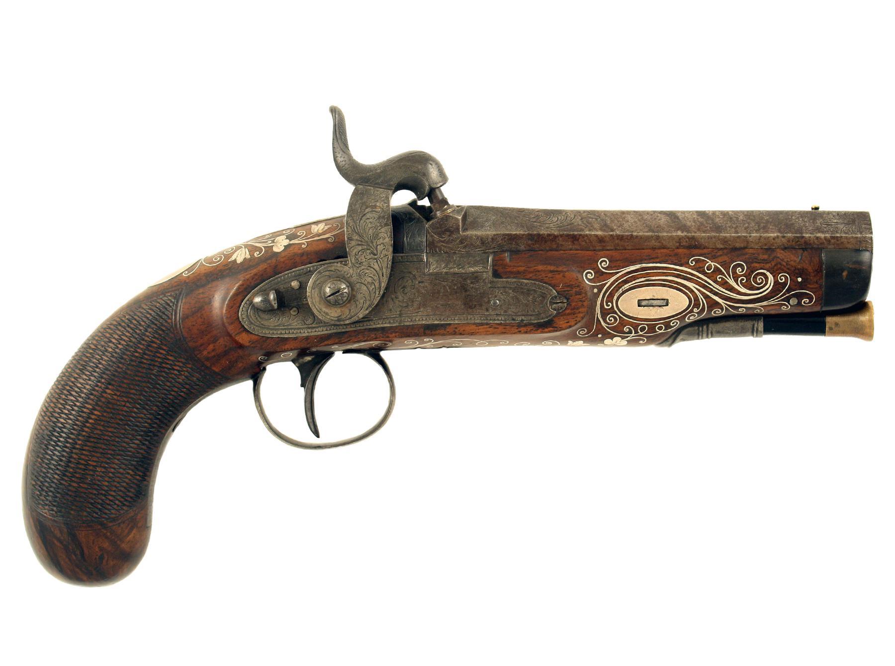 A Fine Silver Inlaid Pistol