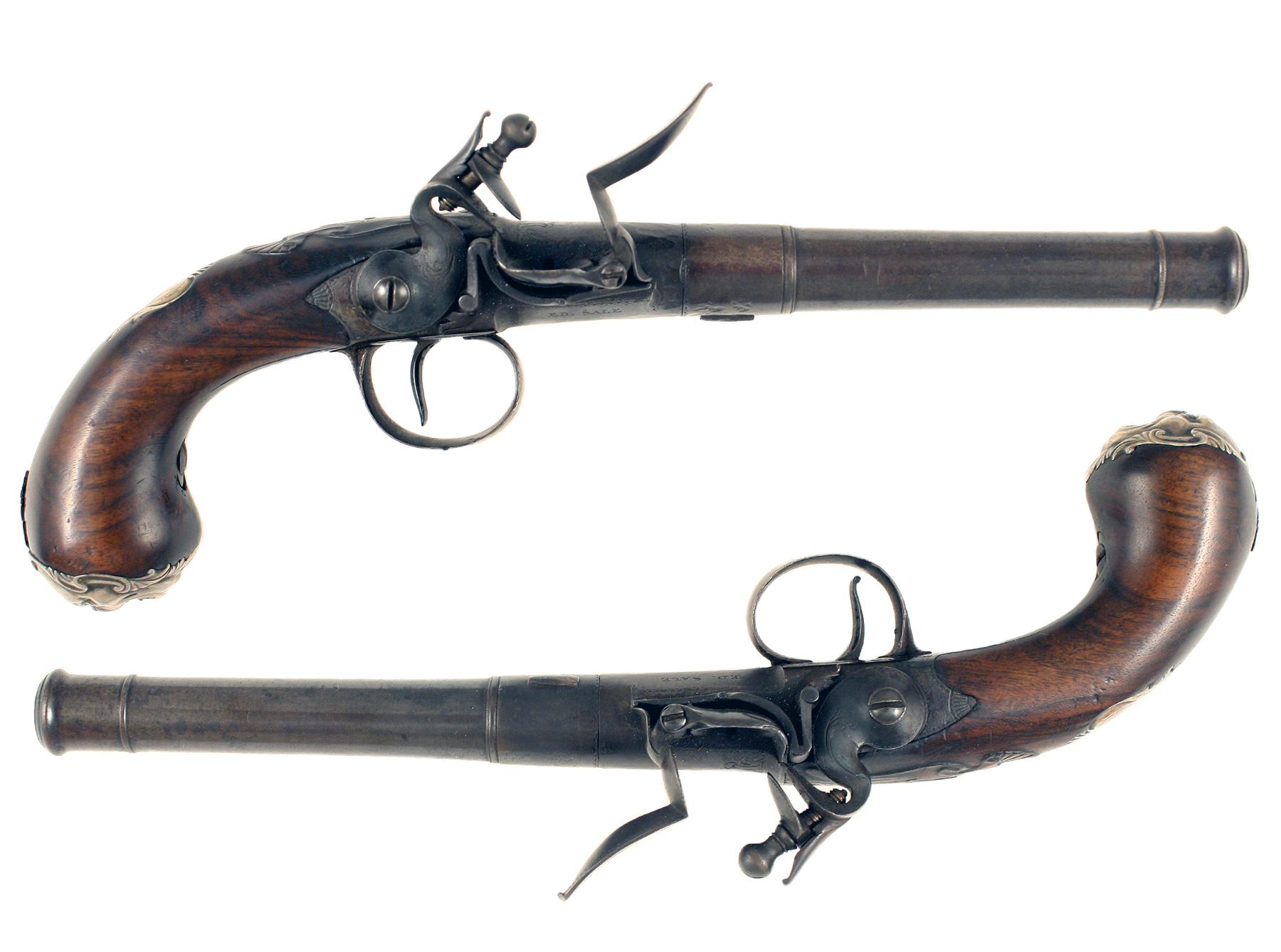 A Pair of Silver Mounted Queen Anne Pistols