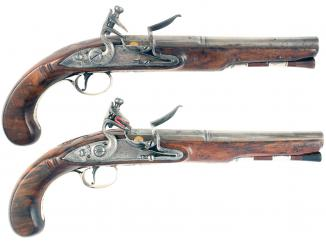 A Pair of Silver Mounted Flintlock Pistols by Bate