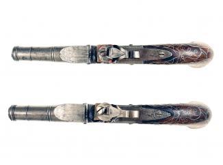 A Pair of Silver Inlaid Flintlock Pistols