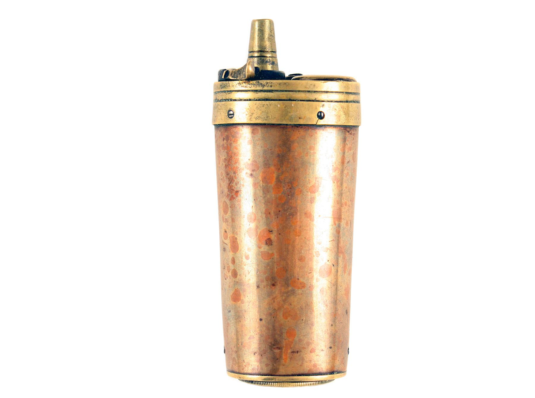 A Three-Way Powder Flask.