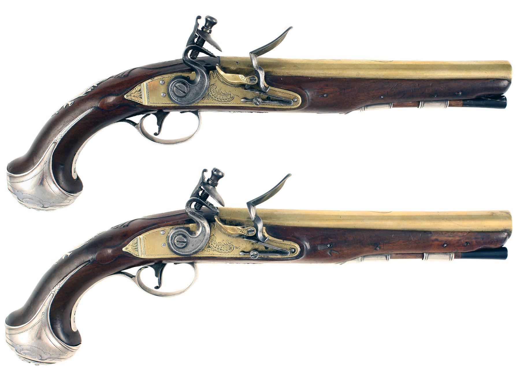 A Pair of Silver Mounted Flintlock Pistols