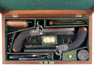 An Unused Pair of Cased Double Barrel Pistols