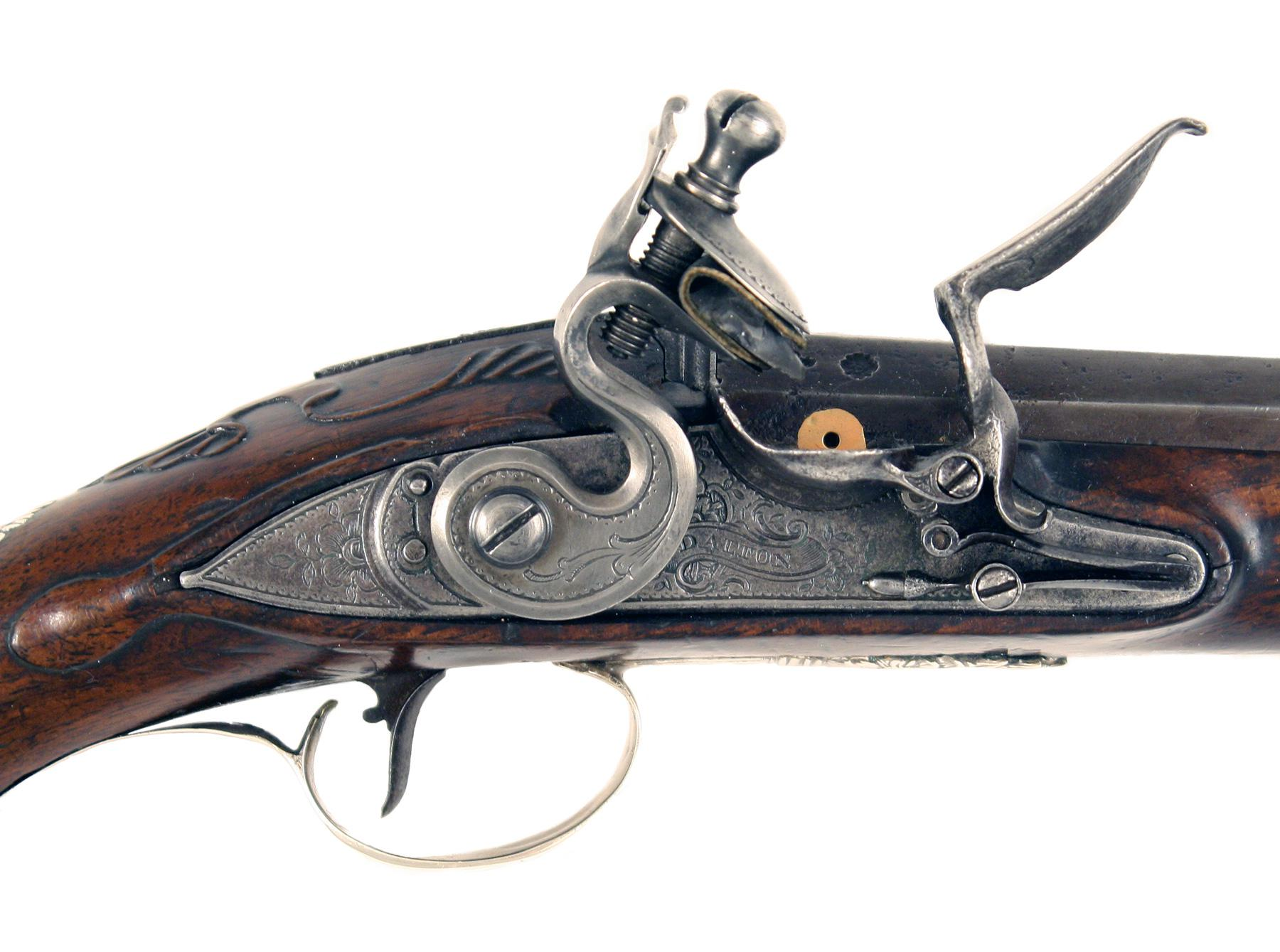 A Pair of Silver Mounted Pistols by Dalton of Dublin
