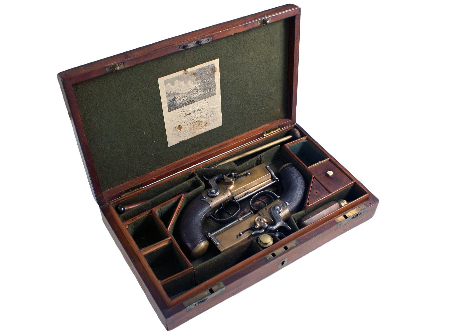 A Cased Pair of Over & Under Pistols
