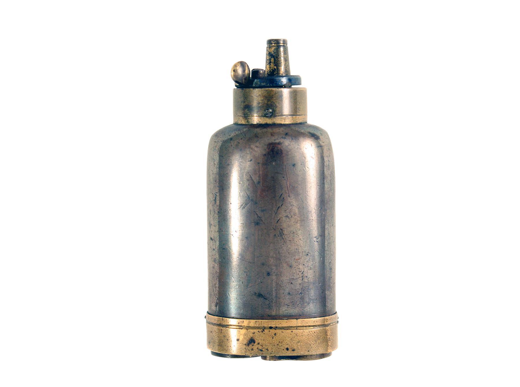 A Bottle Shaped Pistol Flask