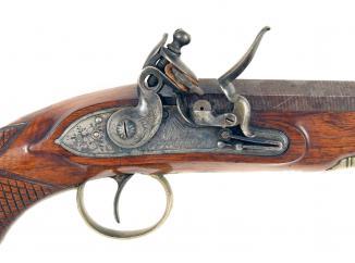A Cased Pair of Flintlock Pistols signed Mortimer.