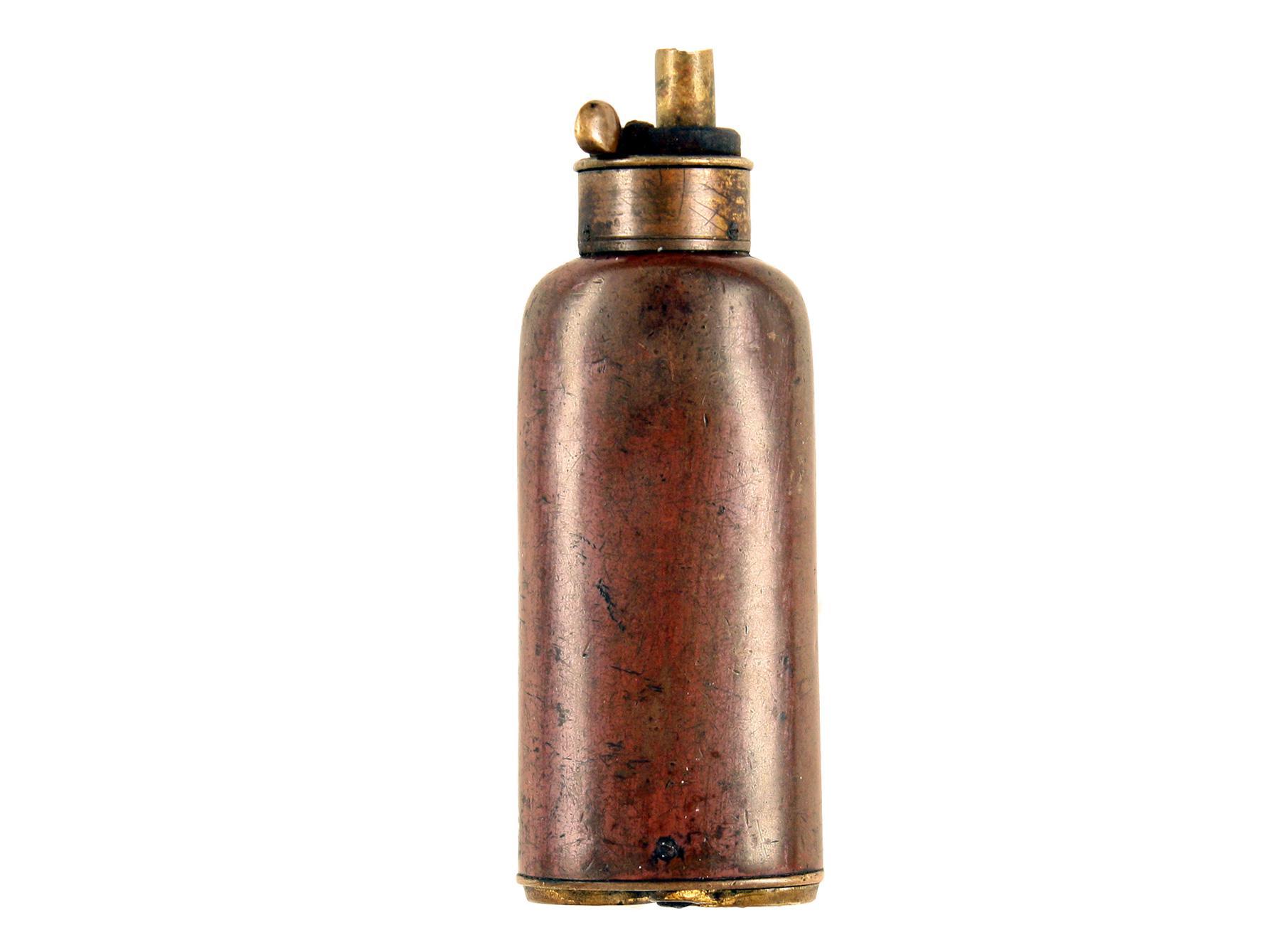A Three-Way Powder Flask.