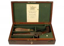 A Cased Double Barrelled Pistol
