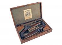 A Cased Pair of Flintlock Pistols by H. Nock